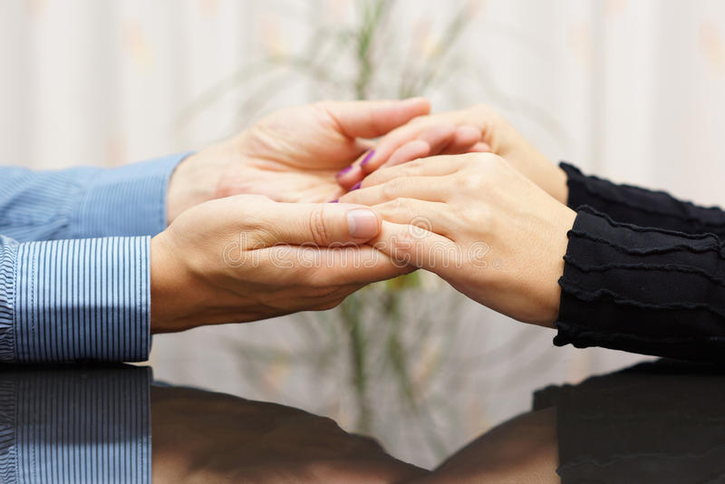 Man holding woman hands. love and care concept royalty free stock photography