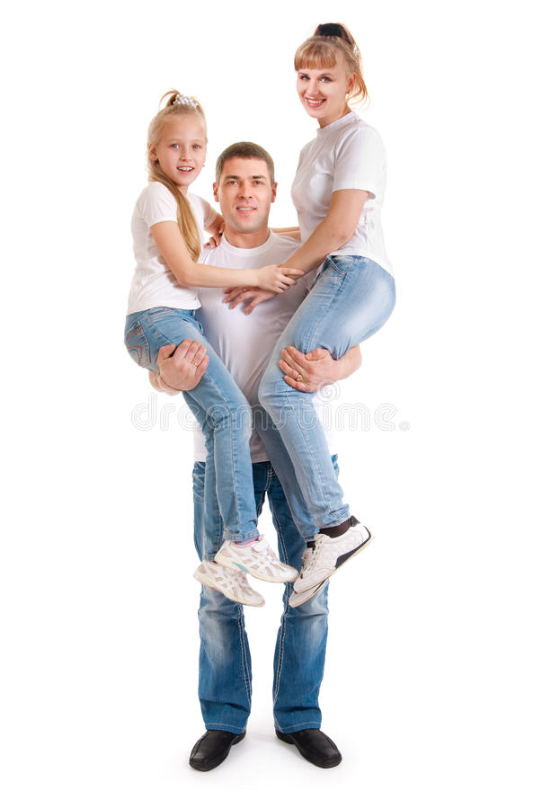 A man holding a woman and her daughter