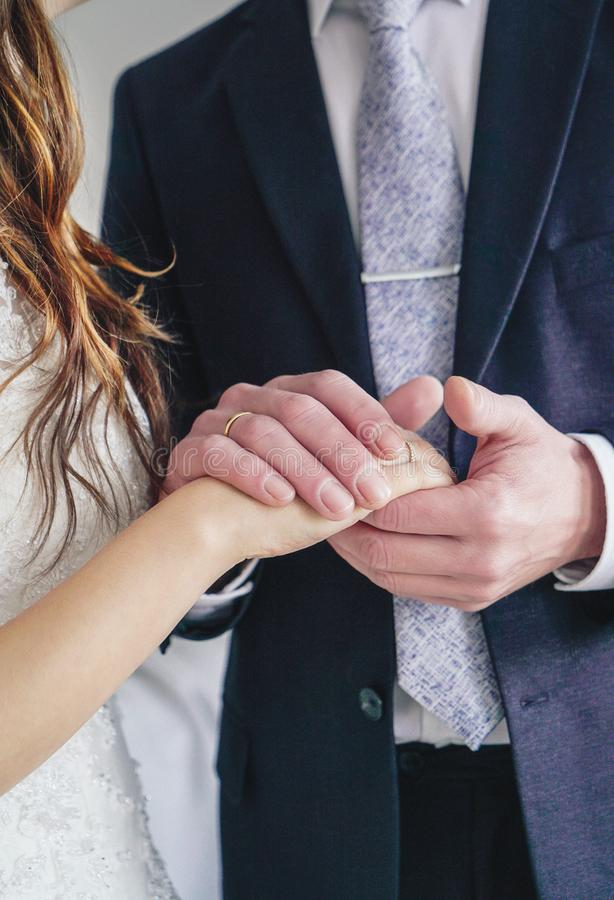 Man holding woman& x27;s hand with engagement ring, wedding day. The Man holding woman& x27;s hand with engagement ring, wedding day stock photography