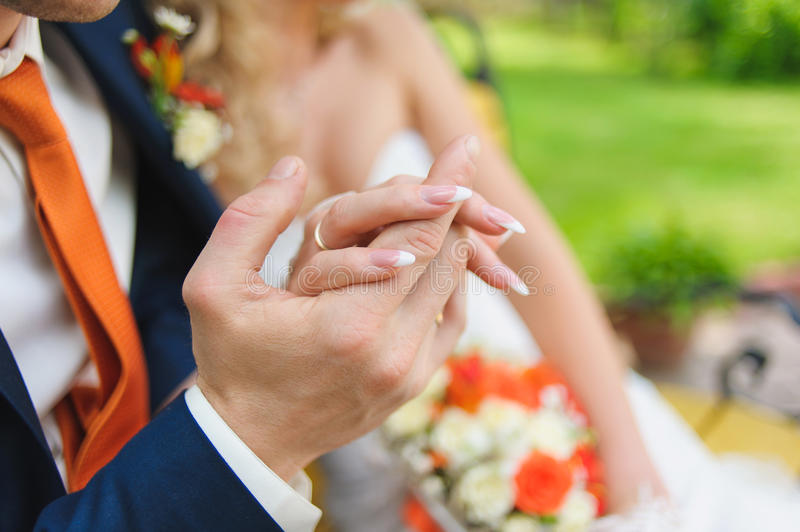 Man holding woman's hand stock image