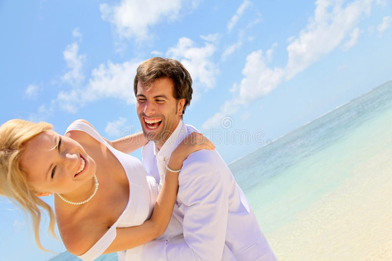 Man holding woman on their wedding day stock photo