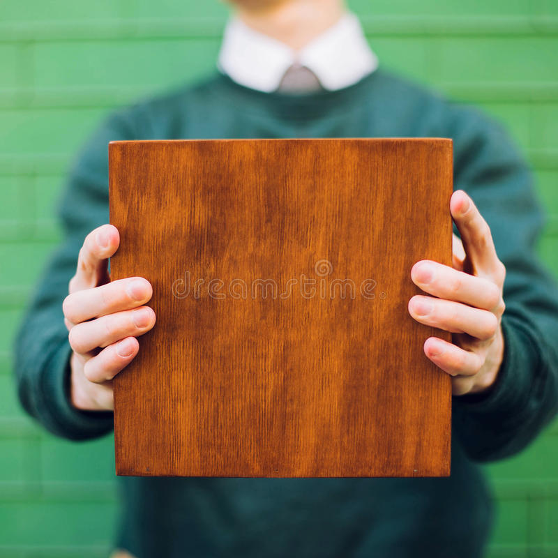A man holding a wooden box royalty free stock image