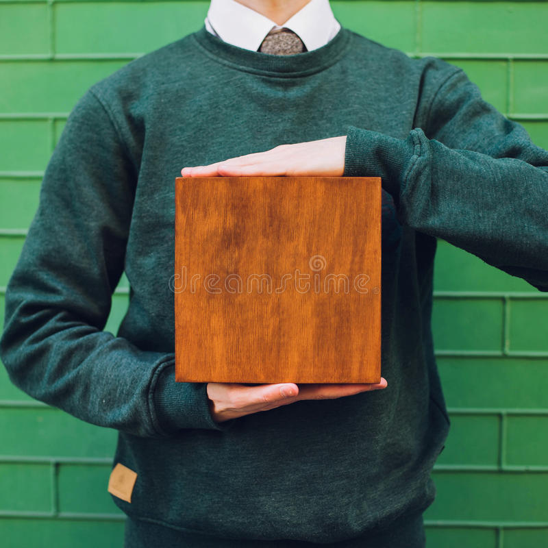A man holding a wooden box royalty free stock photo