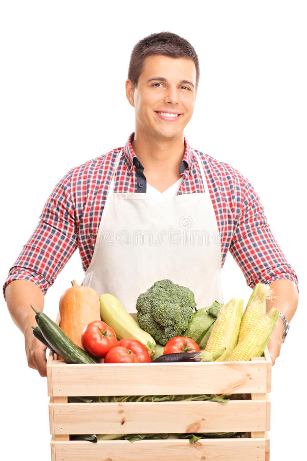 Man holding a wooden crate full of vegetables stock photos