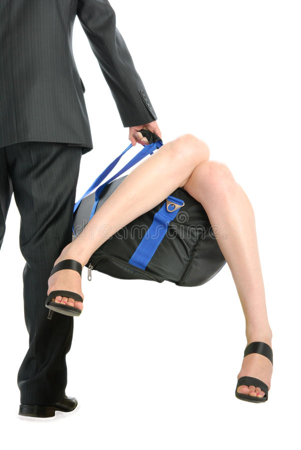 Man holds bag with sticking out female feet stock photo