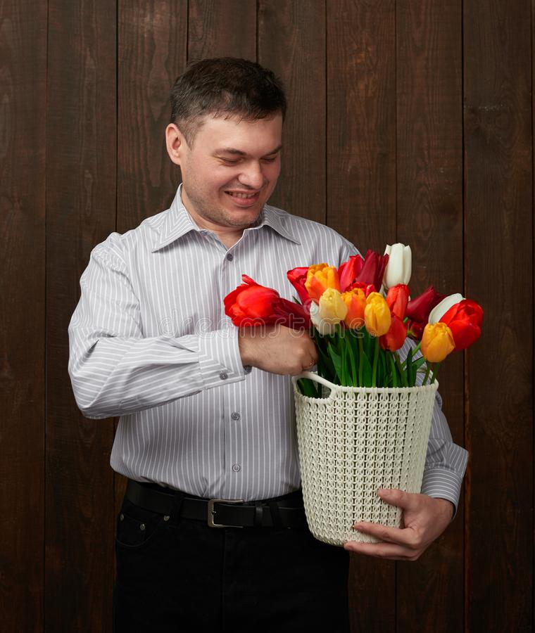 Man holds a basket with flowers royalty free stock photo