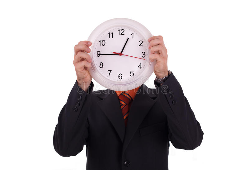 Man holds a clock. Isolated stock photography