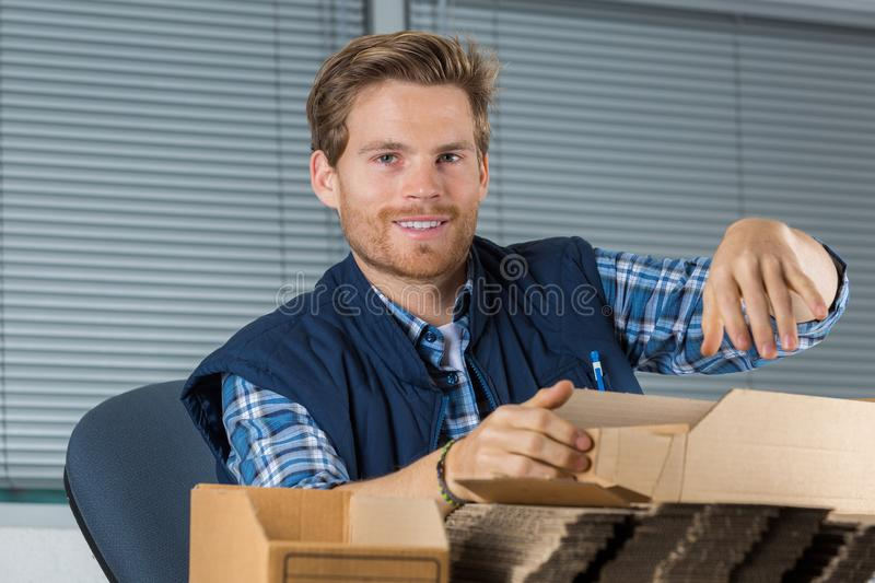 Man holds envelopes in office stock photography