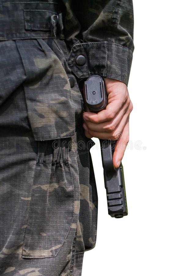 A man holds a gun. Close-up on a white background. Back view royalty free stock images