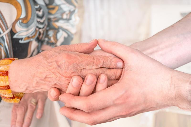 Man holds hands of eldery woman. Senior help concept.  royalty free stock images
