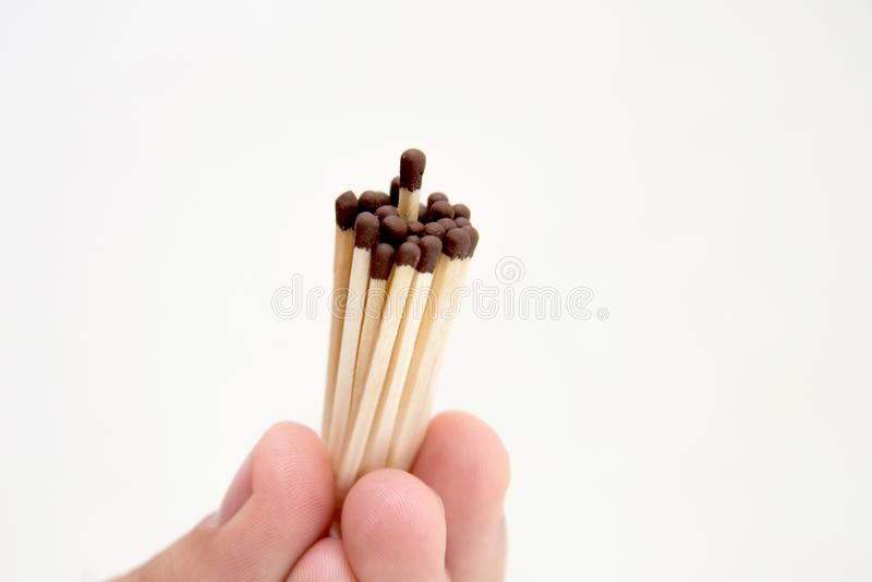 A man holds a match in his hand stock photo