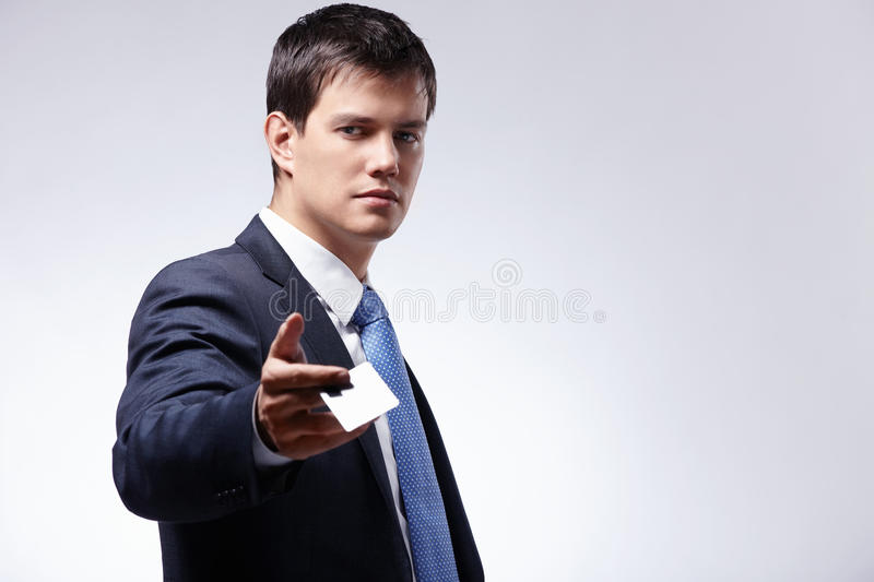 Download A Man Holds Out A Credit Card Stock Image - Image: 18494671