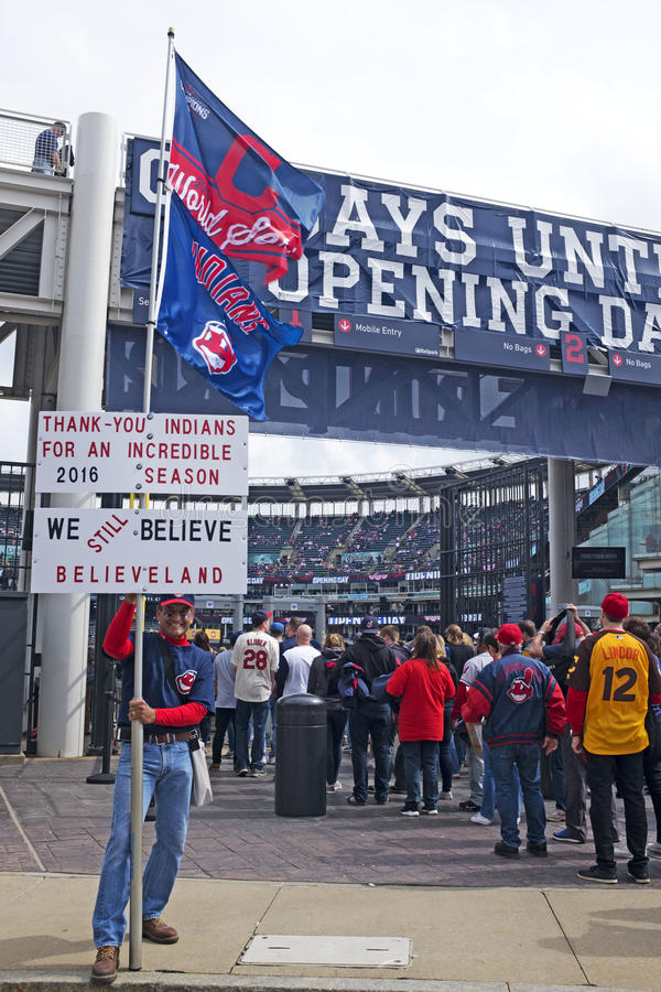 Man holds signs at Progressive Field on opening day in Cleveland, Ohio, USA. The Cleveland Indians opening day baseball game on April 11, 2017 in Cleveland, Ohio stock photography