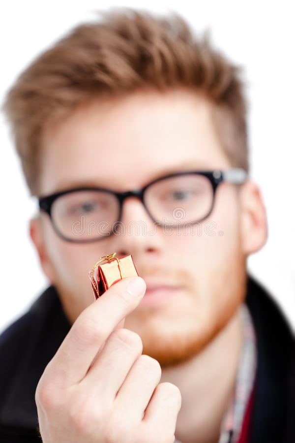 Man Holds Small Toy Present Royalty Free Stock Image