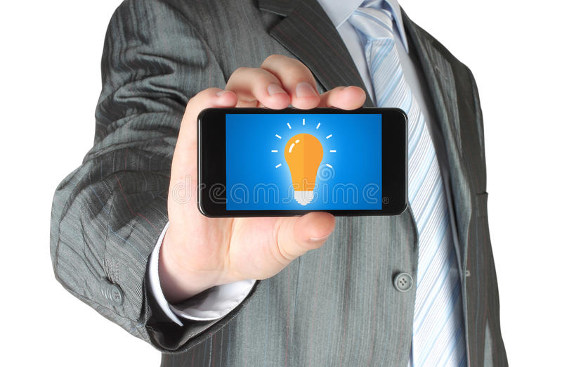 Man holds smart phone with idea concept. On white background royalty free stock photography