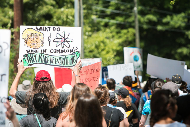 Man Holds Up Funny Sign At Atlanta March For Science stock photography