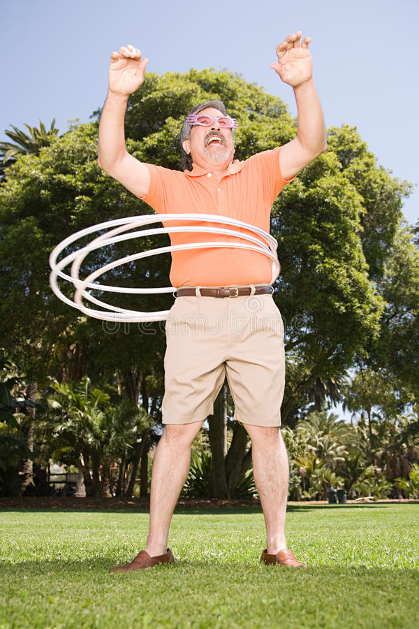 Man with hoops stock photo
