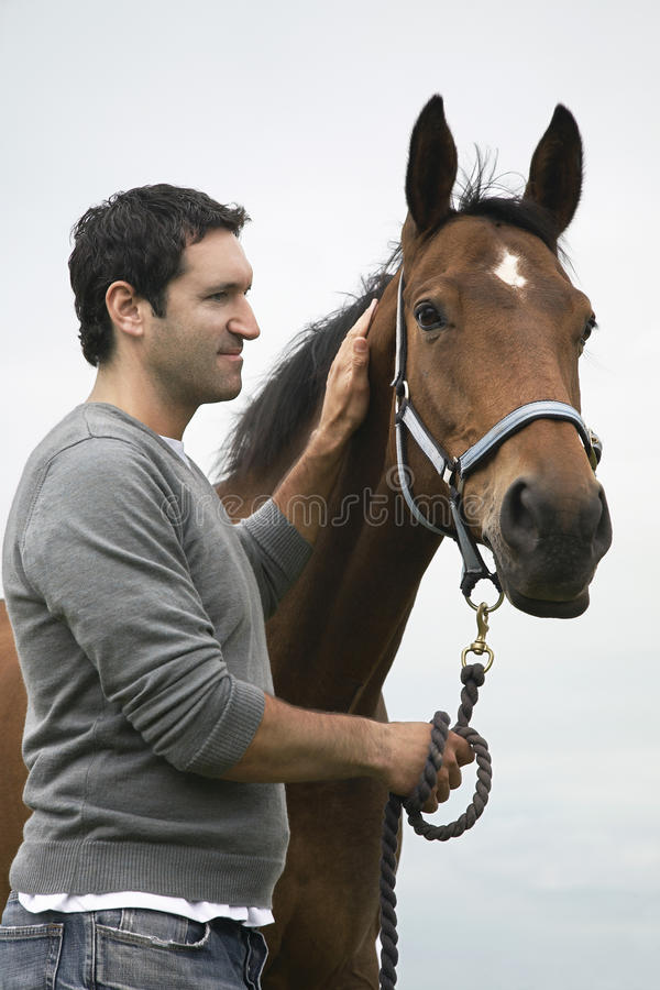 Man With Horse Outdoors