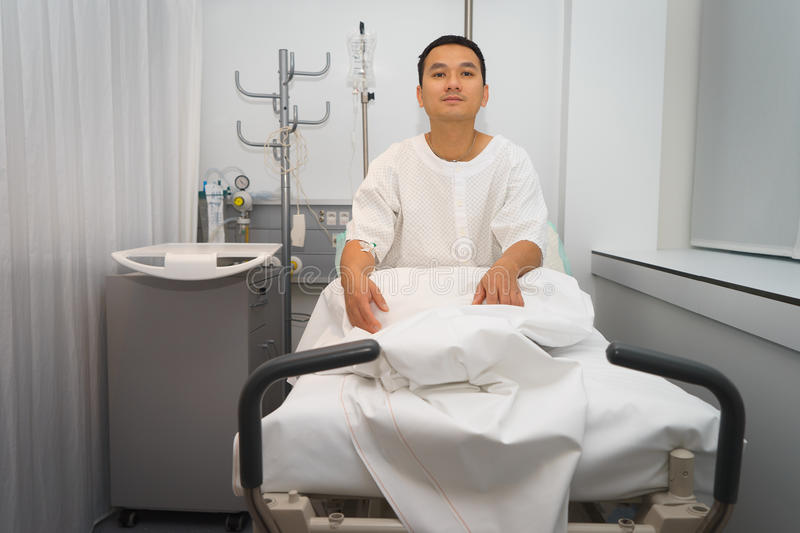 Man in hospital bed. Man asia in hospital bed . He is a patient in the emergency room stock photo