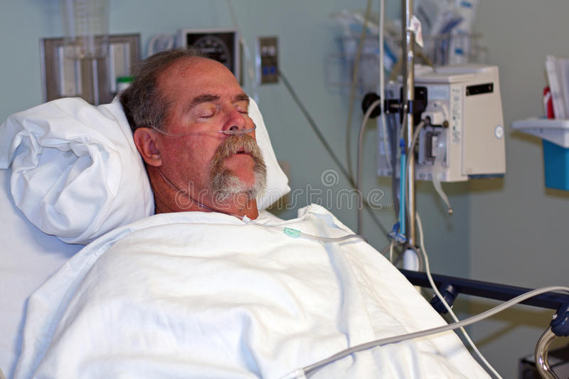 Man in hospital bed asleep royalty free stock images