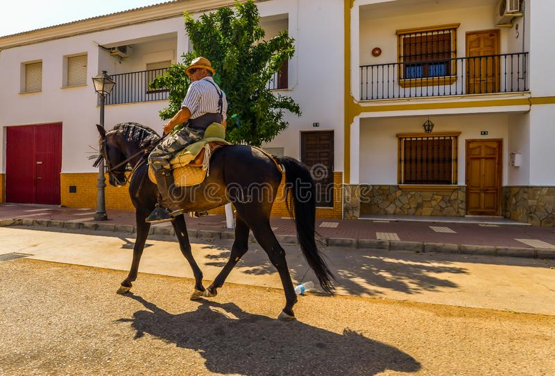 A man on a house. Fuente de Piedra/Spain - 08/20/18 - A man travelling through an Andalucian village stock photo