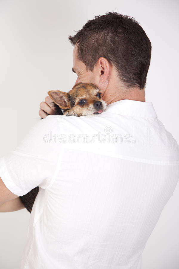 Man hugging cute puppy royalty free stock photo
