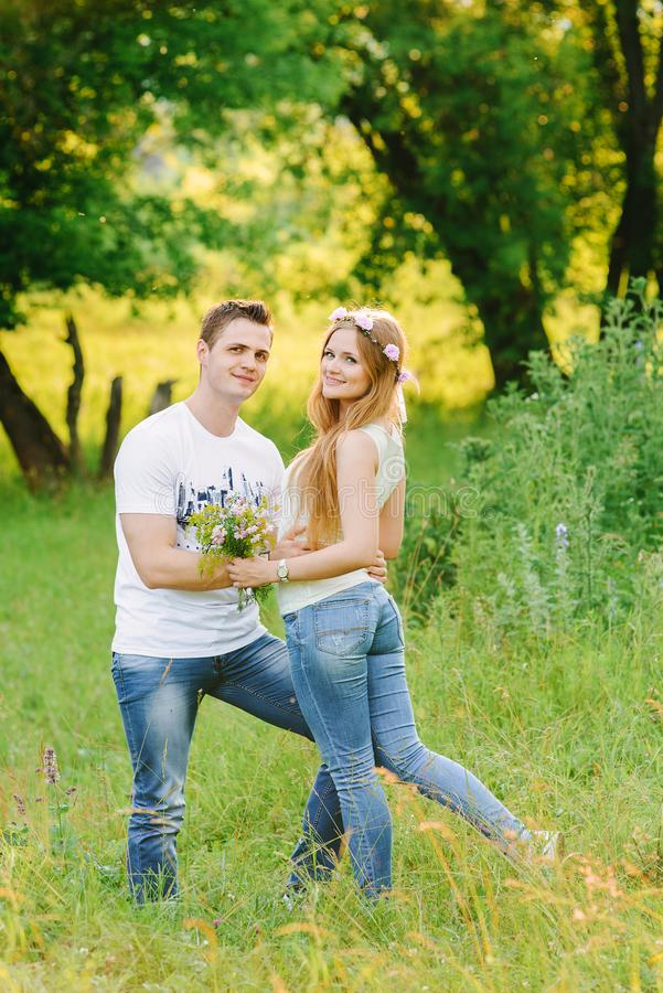 Man hugging his girl standing back to the camera stock photos
