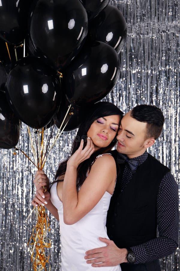Man hugging his woman stock photo