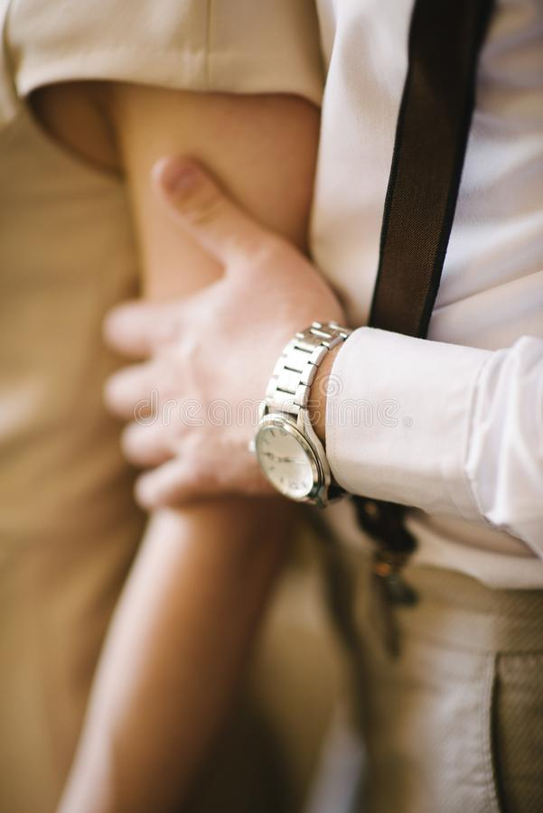 Man hugging a woman in a dress close-up stock photo
