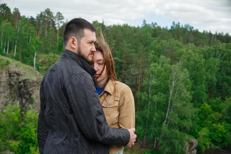 A man hugs a woman on top of a mountain royalty free stock photography