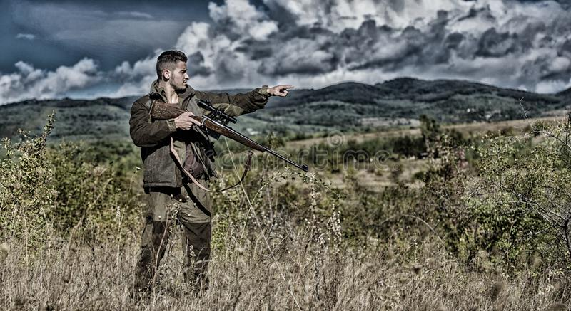 Man hunter aiming rifle nature background. Experience and practice lends success hunting. Guy hunting nature environment royalty free stock image