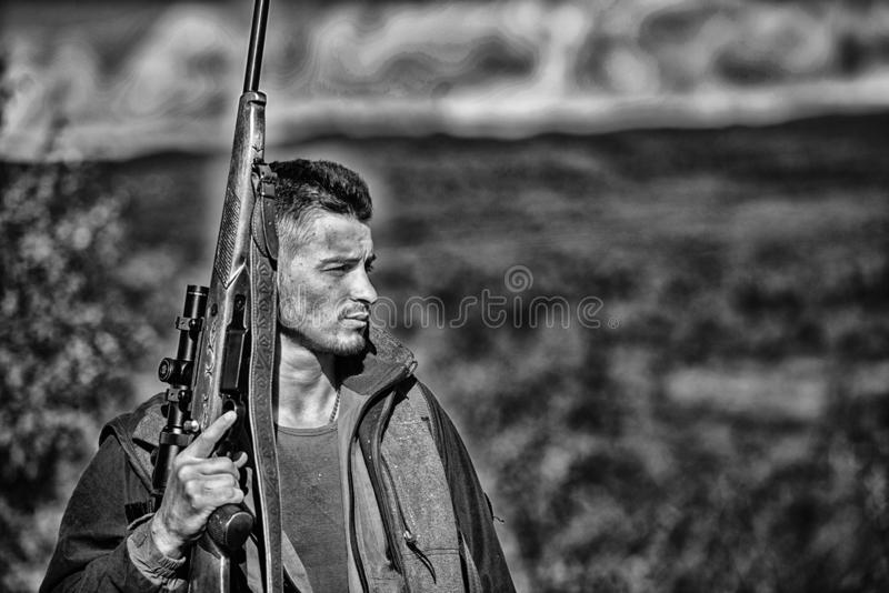 Man hunter carry rifle nature background. Experience and practice lends success hunting. Guy hunting nature environment royalty free stock photo