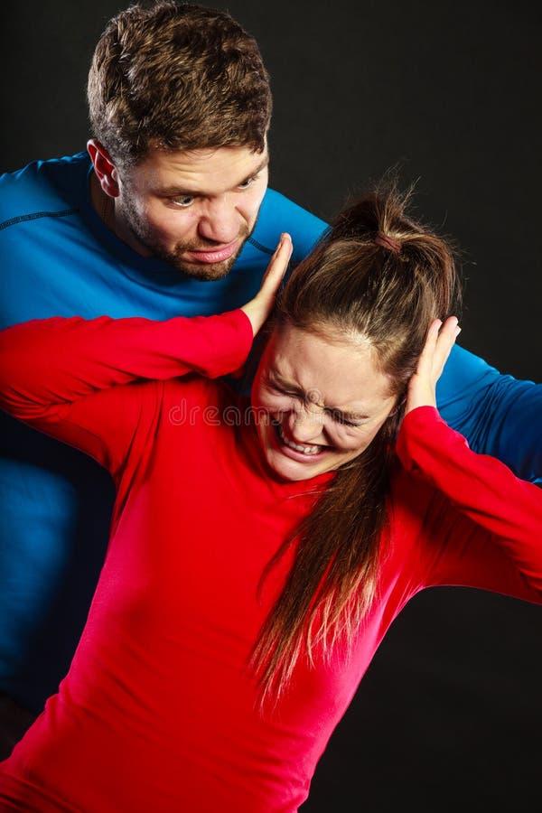 Man husband abusing woman wife. Violence. stock image