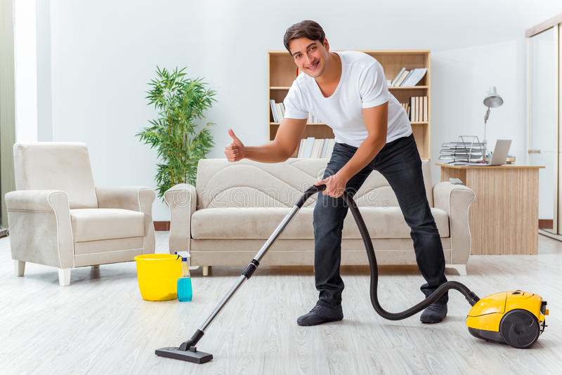 The man husband cleaning the house helping wife stock for House cleaning stock photos