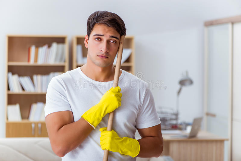 The man husband cleaning the house helping wife stock photo