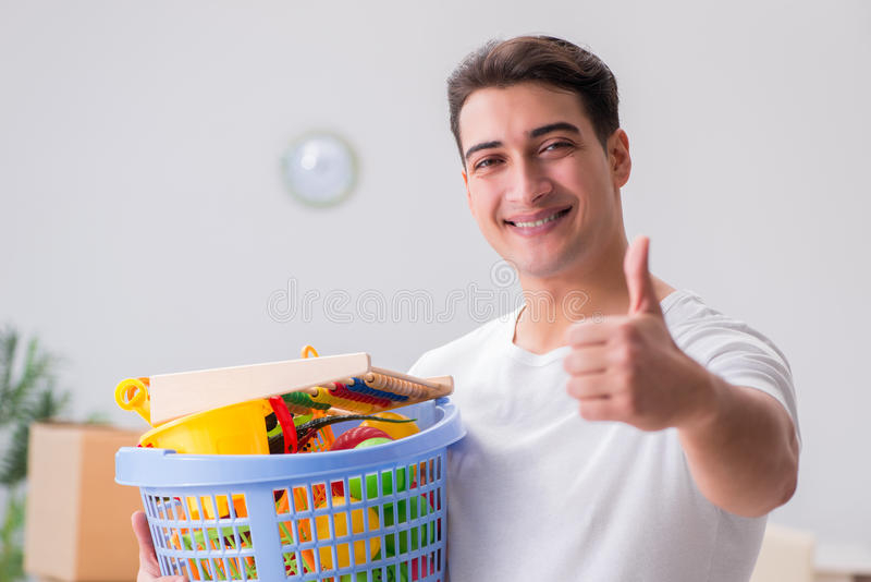 The man husband cleaning toy after kids. Man husband cleaning toy after kids royalty free stock photo