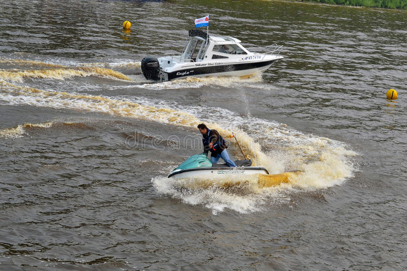 The man on a hydrocycle floats down the river. The man on a hydrocycle floats down the river stock photos