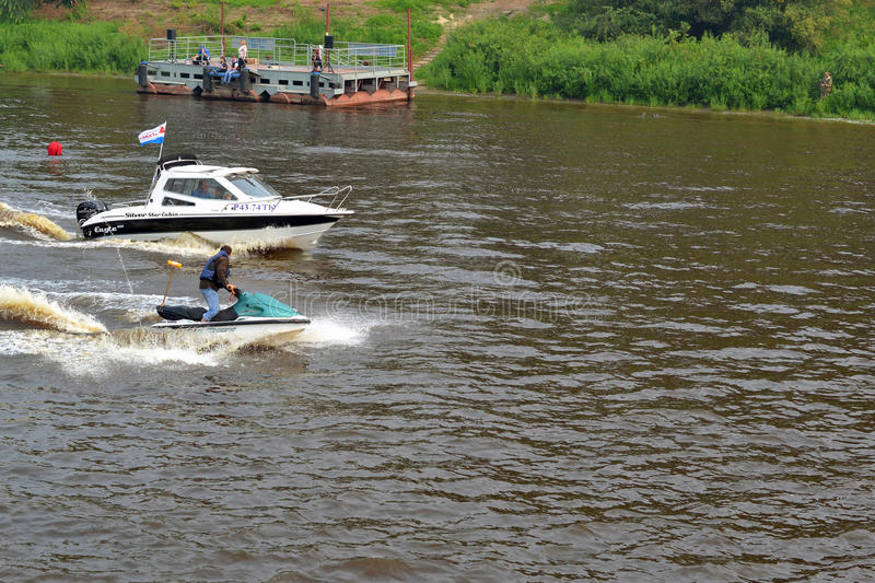 The man on a hydrocycle floats down the river. The man on a hydrocycle floats down the river stock photo