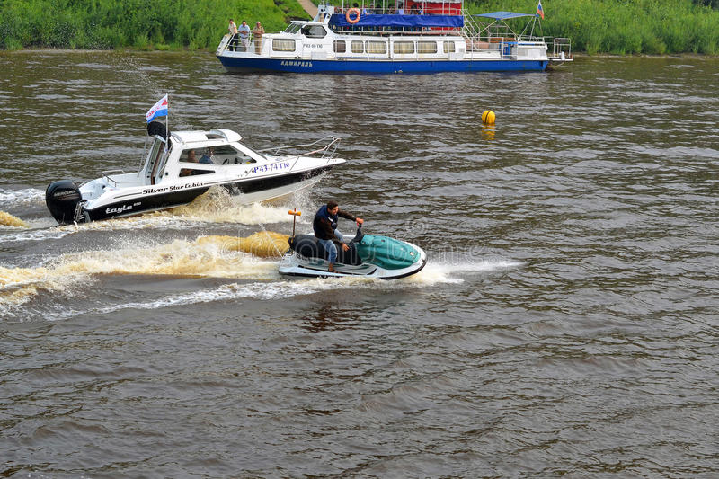 The man on a hydrocycle floats down the river. The man on a hydrocycle floats down the river stock image