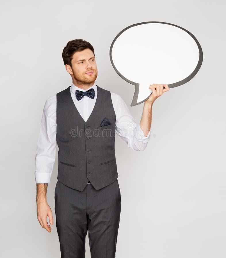 Man i baner för bubbla för text för dräktinnehavmellanrum royaltyfri fotografi