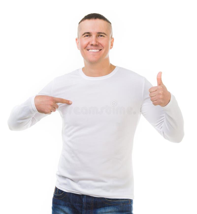 Man i en vit skjorta med långa muffar royaltyfria bilder