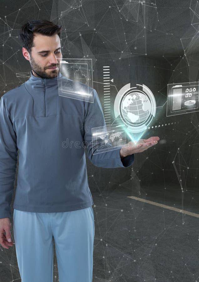 Man i ett futuristiskt rum med världsmanöverenheten royaltyfri foto