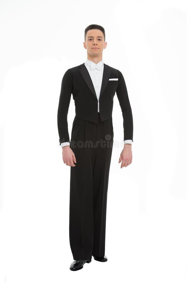 Man i full längd för svart dräkt som isoleras på vit, dans Balsaldansare i smoking med flugan, mode Dans, kapacitet eller ent royaltyfri fotografi