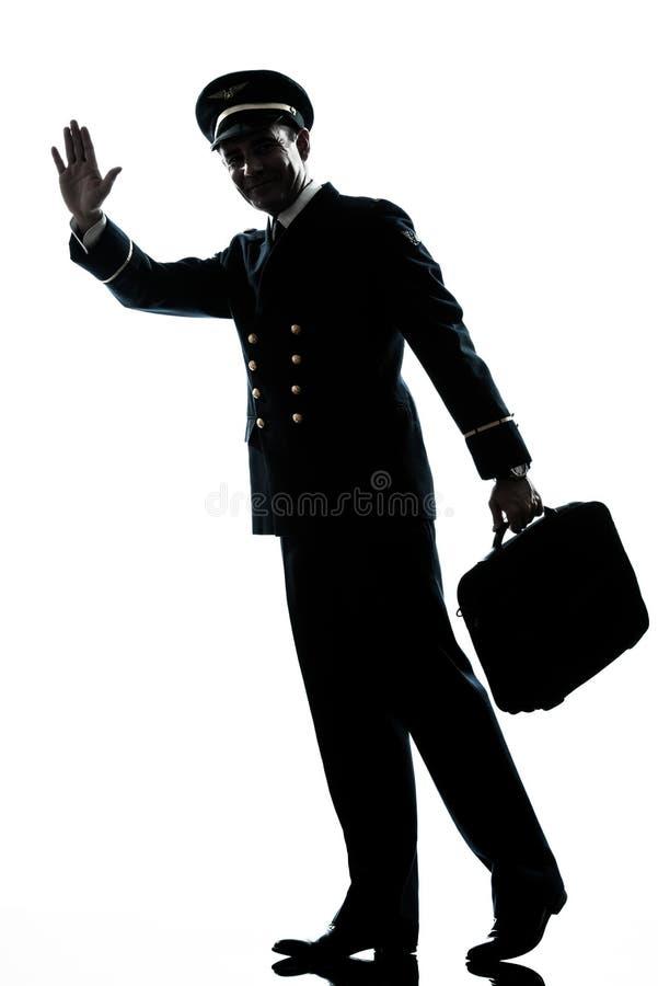 Man i gå för silhouette för flygbolagpilot uniform arkivbild