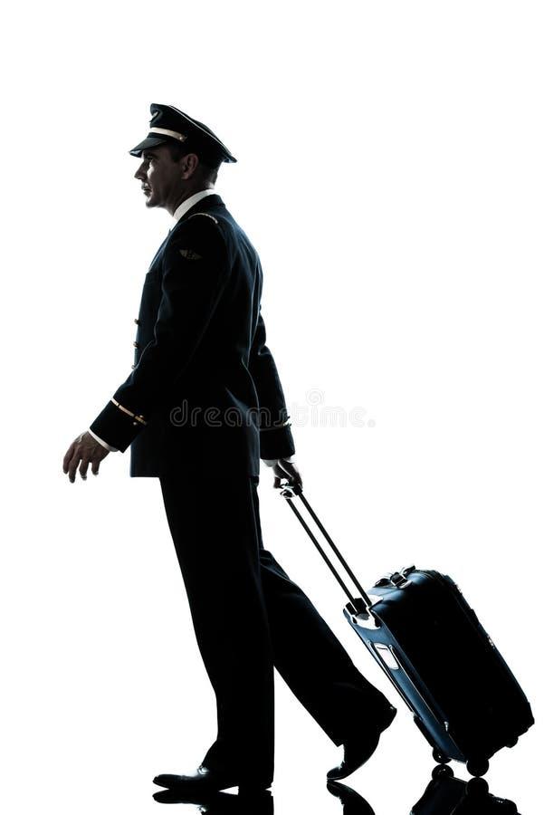 Man i gå för silhouette för flygbolagpilot uniform arkivbilder
