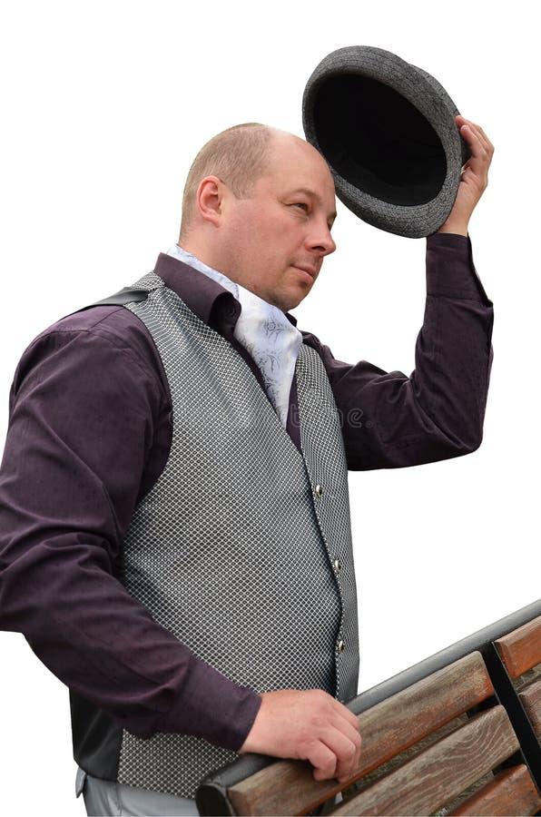 Man i hatt och väst på vit bakgrund royaltyfri fotografi