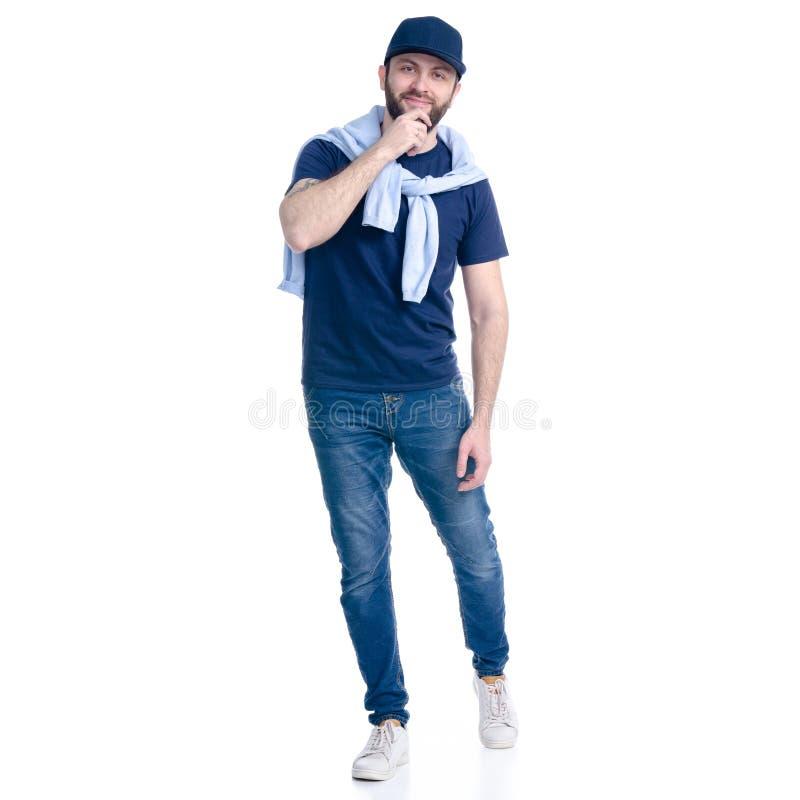 Man i jeans, t-skjorta och lock som går att le fotografering för bildbyråer