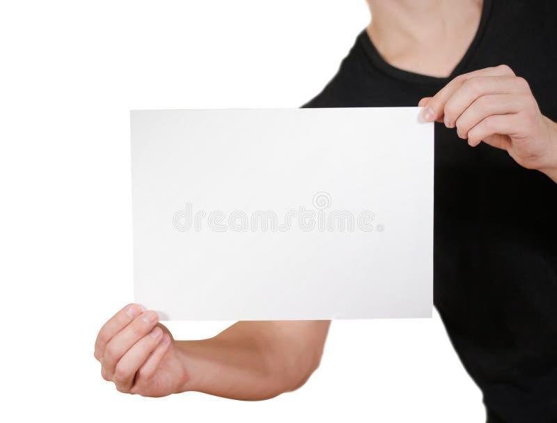 Man i svart papper för vit A4 för mellanrum för t-skjortainnehav Prese broschyr arkivbilder