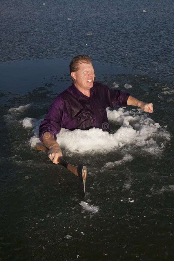 Download Man In Ice Hole Hold Axe Freezing Stock Photo - Image: 36708702