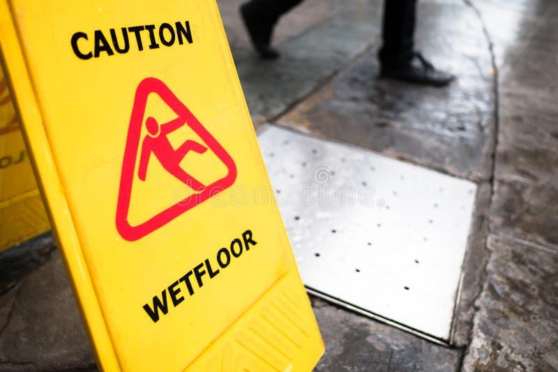`man icon slip on wet floor`, yellow plastic stand signage stock photos